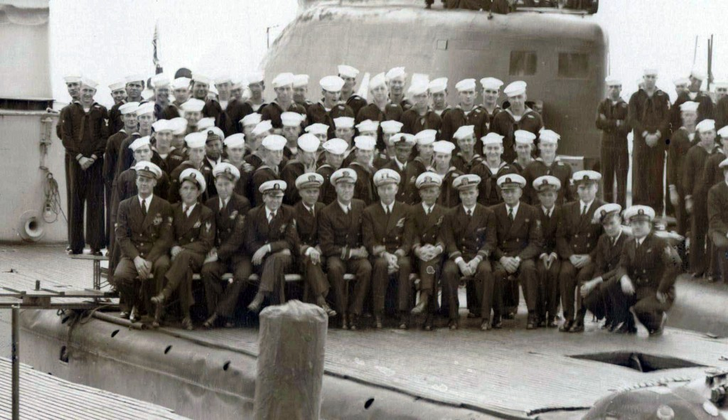 USS Charr (SS-328) crew in 1949.  Commander Fahy is seated 7th from the left wearing Commander's stripes and gold braid on his hat.